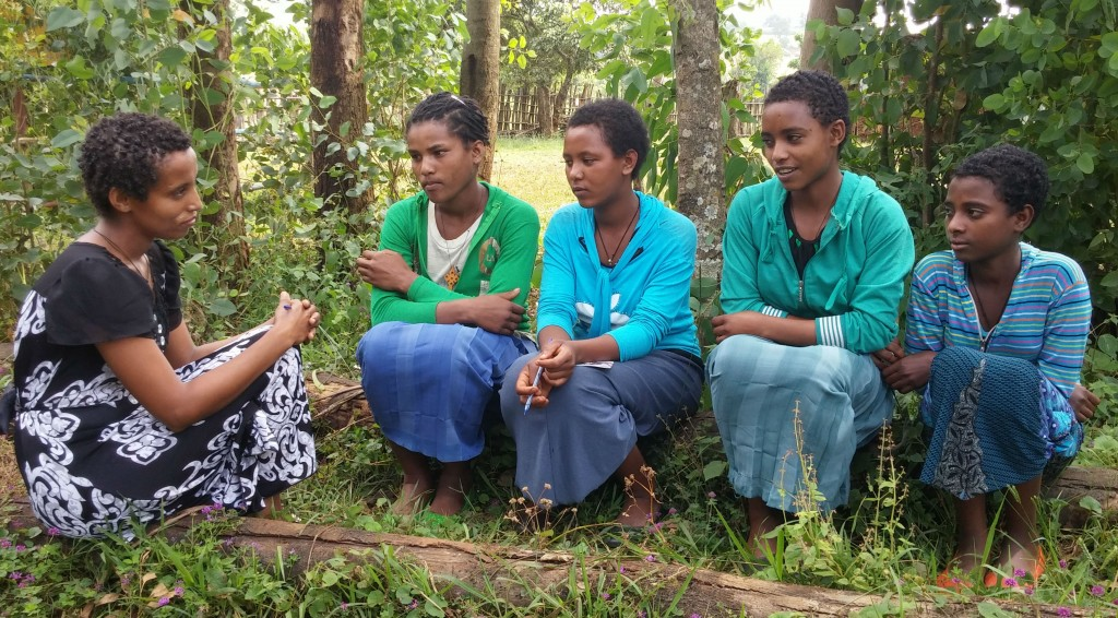 Teacher Selamawit Yigezau, 24, chair of the Girl's Advisory Committee, pictured discussing child marriage with four girls aged 12-15 at Wondefay Primary School in Wondefay Kabele (neighbourhood), Dangla Woreda (district), Amhara, Ethiopia. The school has intervened to prevent 6 child marriages last year.